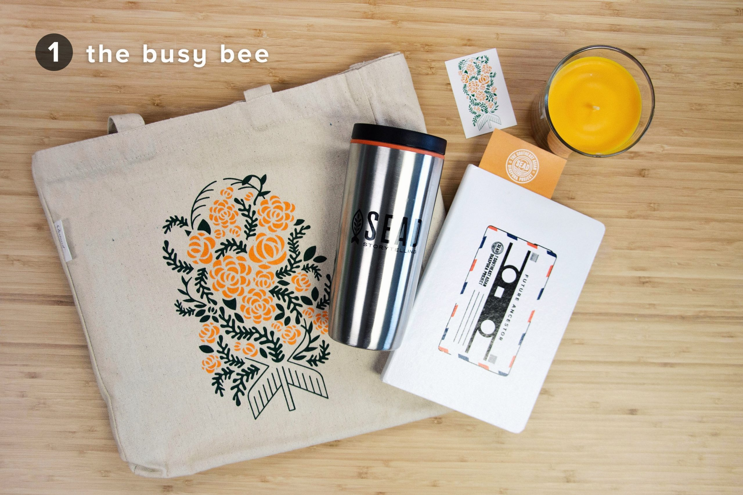 The Busy Bee: Flower Bomb tote bag, SEAD tumbler, Dear Village journal